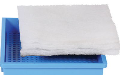 A poly-fiber filter pad on top of a trickle down tray.